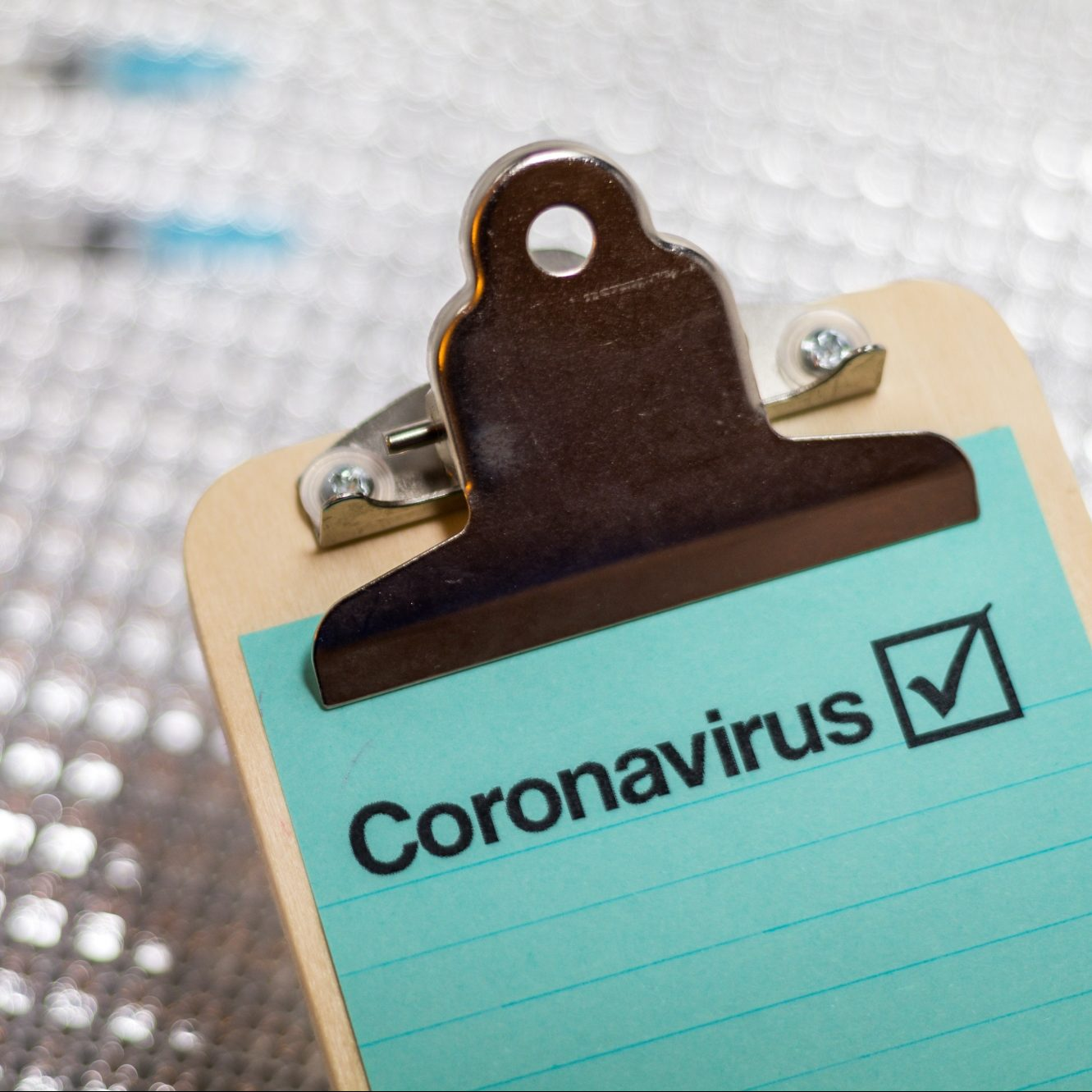 "Clipboard with the word ""Coronavirus"" shown"